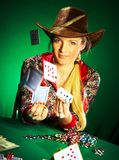 Girl with a beard plays poker Stock Image