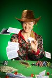 Girl with a beard plays poker Stock Photos