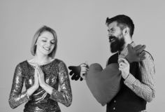 Girl and bearded man with pleased faces play with heart royalty free stock image