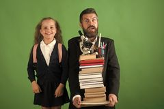 Girl and bearded man in suit. Classroom and alternative education Royalty Free Stock Photo