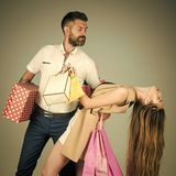 Girl and bearded man hold present pack, cyber Monday. Royalty Free Stock Image