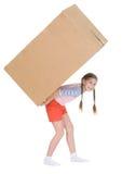 Girl bears the big heavy cardboard box. Little girl bears the big heavy cardboard box on a back Stock Image