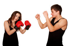 The girl beating the guy, the guy defending himself. stock photos