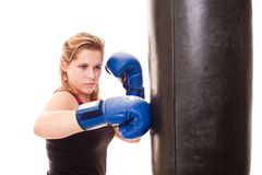 Girl beats a boxing bag Royalty Free Stock Photography