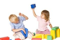 Girl beats boy toy. White background royalty free stock photos