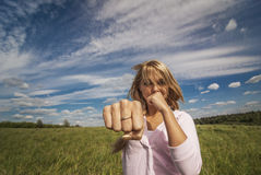 Girl beats fist Royalty Free Stock Photography