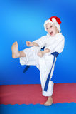 Girl beats a kick in the hat of Santa Claus. Girl beats kick in the hat of Santa Claus stock image