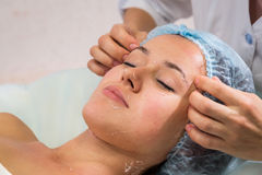 Girl with a beautician at spa salon Stock Photo
