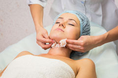 Girl with a beautician at spa salon Royalty Free Stock Image