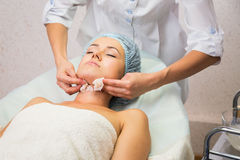 Girl with a beautician at spa salon Stock Images