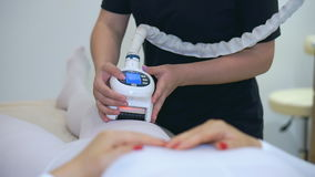 The girl beautician uses modern cosmetic equipment. Hardware laser therapy. Laser therapy for body and face. Modern technologies for rejuvenation SPA stock video footage