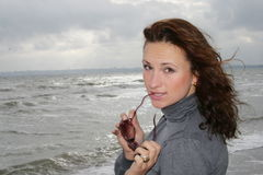 The girl beautiful. The girl at sea coast royalty free stock image