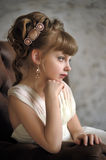Girl with beautiful antique hairstyle Stock Images