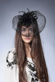 Girl in a beautiful hat Stock Photography