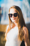 Girl. Beautiful blond model with glasses Royalty Free Stock Images