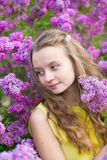 Girl and beautiful blooming lilac Royalty Free Stock Photo