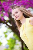 Girl with beautiful blooming tree Royalty Free Stock Photo