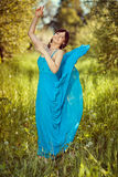 Girl in a beautiful blue fluttering dress. Stock Photo