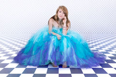 Girl in a beautiful blue party dress Stock Photos