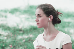 Girl beautiful brunette listening to music Royalty Free Stock Photography