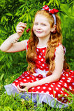 Girl in a beautiful dress in garden. Girl in a beautiful dress in cherry garden Stock Image