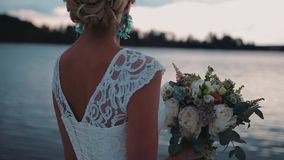A girl in a beautiful dress is on the pier. Rear view. The camera is in motion. stock video
