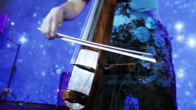 Playing on the cello stock video footage