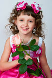 The girl in a beautiful dress with rose Royalty Free Stock Photos