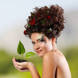 Girl beautiful ecology with green tree Royalty Free Stock Image