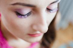 Girl with Beautiful eyelashes. A girl with a beautiful purple eyelashes buried the eye beautiful makeup, fashion Stock Photo