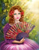 Girl beautiful with a fan against a grape garden. Label wine Royalty Free Stock Photo