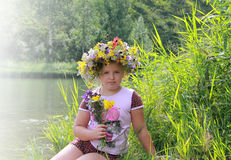Girl in a beautiful flower wreath Stock Photography