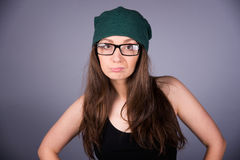 Girl. Beautiful girl in glasses on gray background Royalty Free Stock Photography