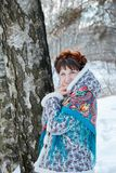 Girl with beautiful hair on her head in Russian folk style in blue shawls royalty free stock photo