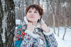 Girl with beautiful hair on her head in Russian folk style in blue shawls stock photo