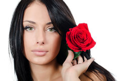 The girl with beautiful hair with a red rose Stock Photos