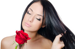 The girl with beautiful hair with a red rose Royalty Free Stock Photos