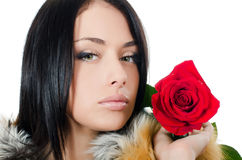 The girl with beautiful hair with a red rose Royalty Free Stock Images