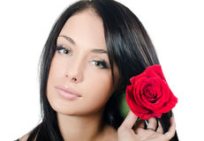 The girl with beautiful hair with a red rose Stock Images