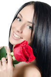 The girl with beautiful hair with a red rose Stock Photo