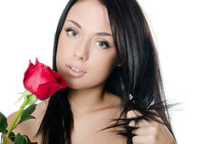 The girl with beautiful hair with a red rose Stock Photography