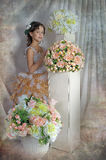 Girl with beautiful hair in a smart dress next to the vases Royalty Free Stock Photo