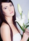 Girl with beautiful lily flower Stock Photos
