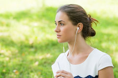 Girl beautiful listening to music Stock Photography