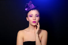 Girl with beautiful make-up. On dark background Stock Images