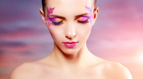 Girl with beautiful makeup. Background of sky Royalty Free Stock Photos