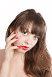 Girl with beautiful nails. Young girl with long red nails and Beautiful hair, over white background stock images