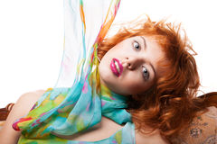 Girl with red hair and colorful dress over white Royalty Free Stock Photography