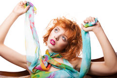 Girl with red hair and colorful dress over white Stock Photos