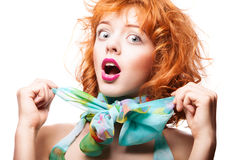 Girl with red hair and colorful dress over white Stock Photography